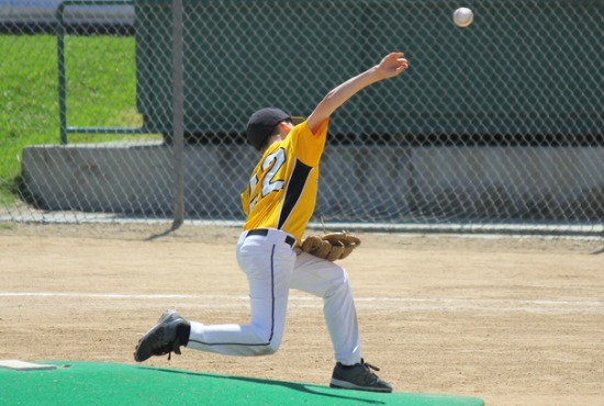 Arm raised when throwing a baseball